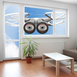 Drone spying through window your living room. Privacy policy concept.