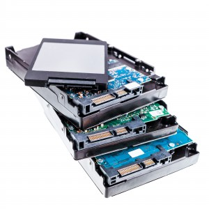 four Hard disk drives, HDD and SSD on white