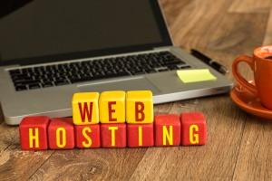 Web Hosting written on a wooden cube in a office desk